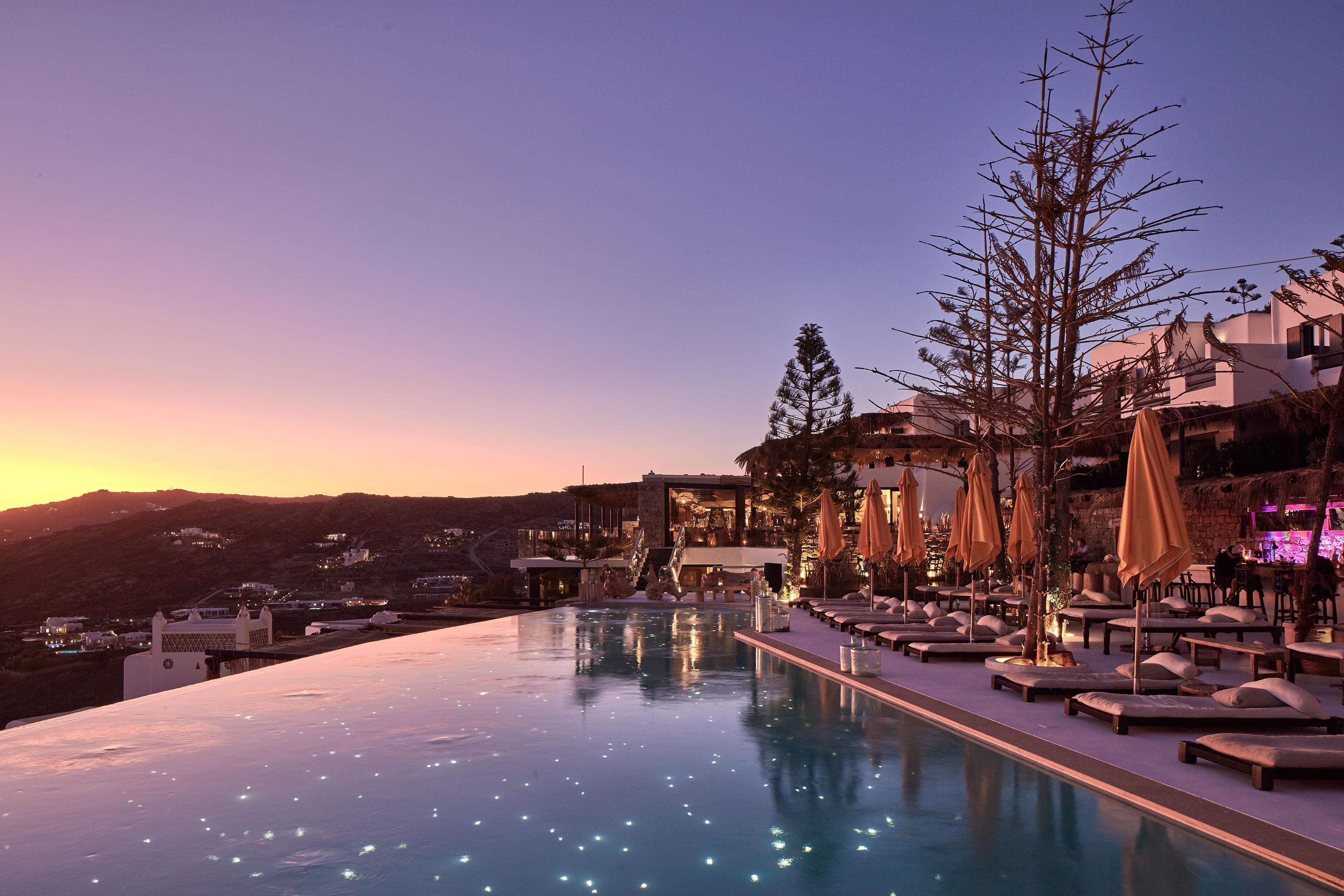 The Myconian Utopia pool at night
